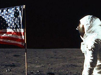 Apollo 11 astronaut Buzz Aldrin salutes the U.S. flag