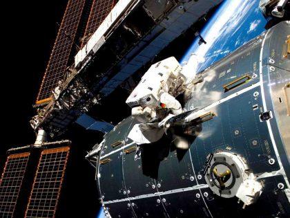 Astronaut works on Columbus (credit ESA)